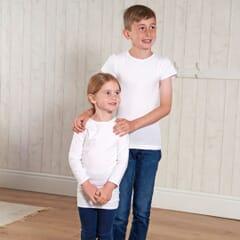 Girl wearing long sleeved hug shirt and boy wearing short sleeved hug shirt.